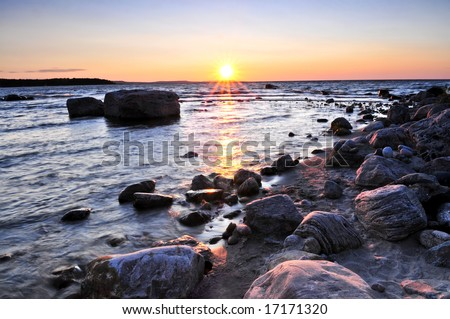 Sunset at the rocky shore of Georgian Bay, Canada. Awenda provincial park. - stock photo
