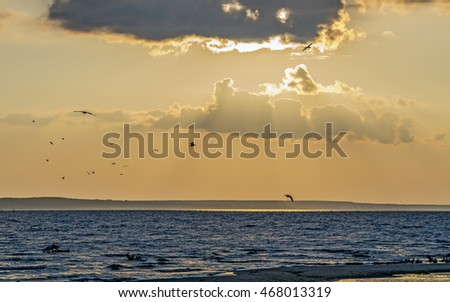 Sunset at the sea with natural light and darkness