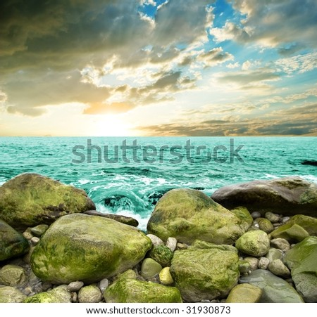 sunset at the seacoast - stock photo