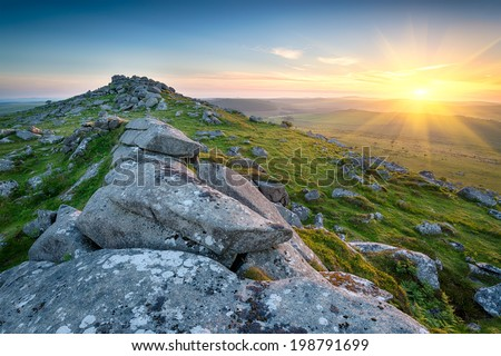 Sunset at the top of Kilmar Tor one of the highest peaks on Bodmin Moor in Cornwall - stock photo