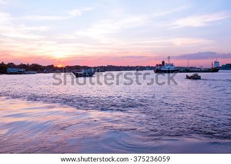 Sunset at the Yangon river in Yangon Myanmar - stock photo