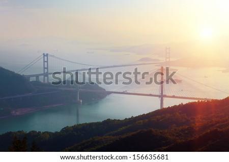 Sunset at Ting Kau Bridge, view from Tsuen Wan, Hong Kong - stock photo