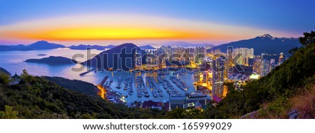 Sunset at typhoon shelter in mountain in Hong Kong - stock photo