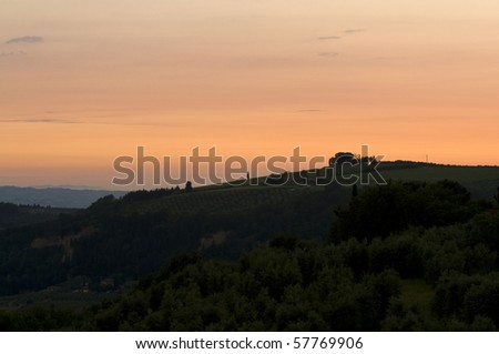 Sunset at typical Tuscan hill