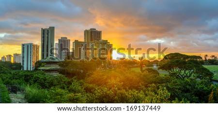 Sunset at Waikiki over the skyline in Oahu, Hawaii. - stock photo