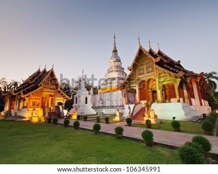Sunset at Wat Phra Singh Woramahaviharn is Thai temple in chiangmai, Thailand - stock photo