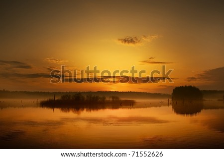 Sunset at water - stock photo