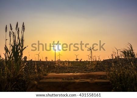 Sunset at wind turbine farm in Thailand - stock photo