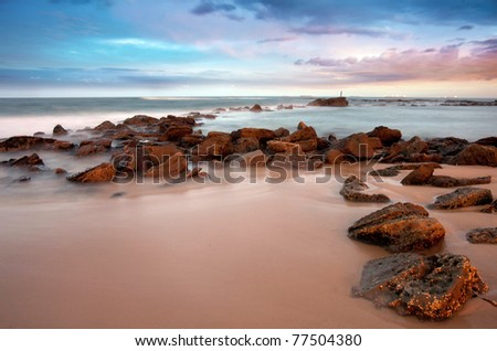 sunset beach at newcastle - stock photo