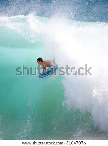 SUNSET BEACH, HAWAII - FEBRUARY 15: An unidentified young man participating in Big Wave Surfing using mini-board, Sunset Beach, Oahu, Hawaii, on February 15, 2009. - stock photo