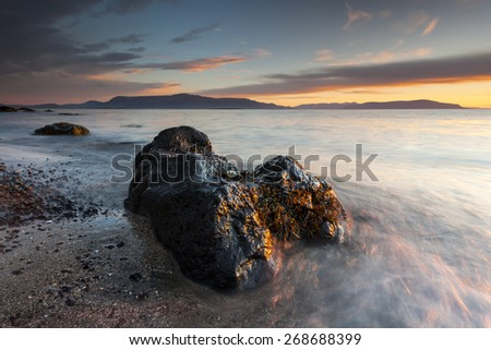 Sunset Beach With Rocks and Full Of Colors.Iceland Coastline Close to Reykjavik City/ Colorful Sunset Rocky Beach - stock photo