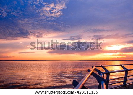 Sunset. Beautiful sunset above  sea. Lake sunet. Amazing sunset Awesome sunset. Sunset  sea waves. Summer sunset. Landscape sunset. Beautiful sunset. Travel sunset - stock photo