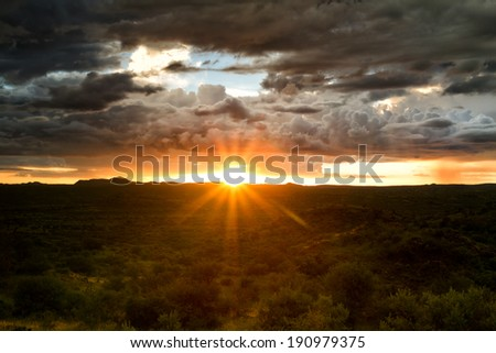 Sunset behind a thunderstorm, Savannah near Windhoek, Namibia - stock photo