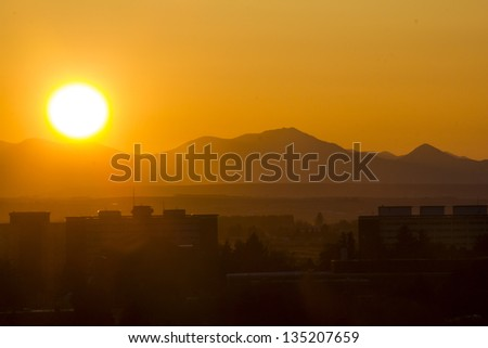 Sunset behind Mountains - stock photo