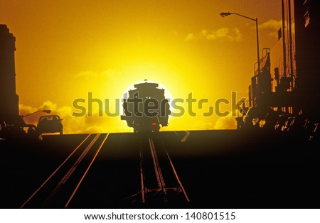 Sunset behind one of San Francisco's famous cable cars, San Francisco, California - stock photo