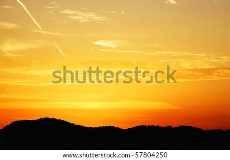sunset behind the mountains - stock photo