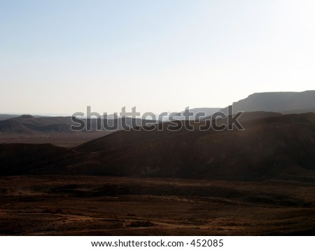 Sunset behind the mountains of the Negev desert in Israel, - stock photo