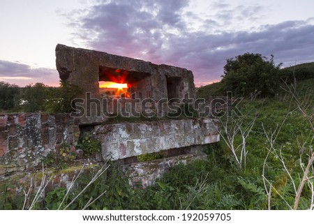 Sunset behind the ruins. - stock photo