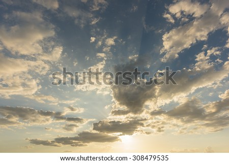 Sunset, blue sky and clouds