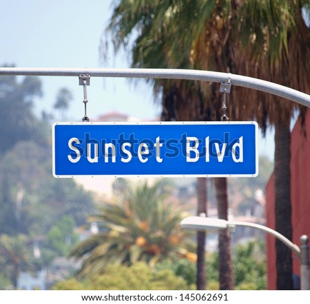 Sunset Blvd street sign with palm trees in Hollywood, California. - stock photo