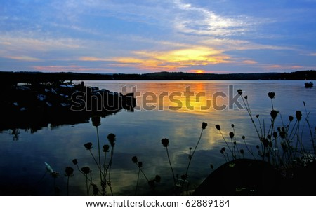 sunset by the lake - stock photo
