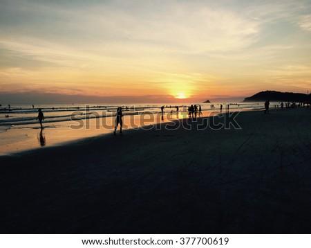 Sunset by the ocean shore in Sao Sebastian, Brazil - stock photo