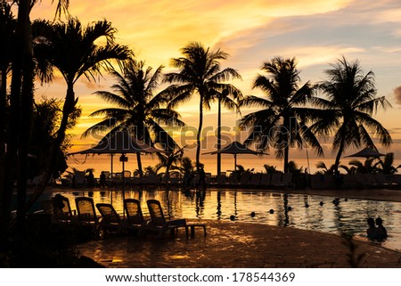 Sunset By The Pool of Pacific sea background./Sunset By The Pool/Sunset By The Pool of Pacific sea background - stock photo