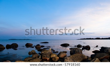 Sunset by the sea in sweden at summer - stock photo