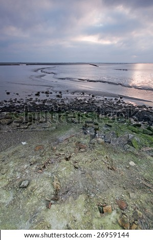 Sunset by the Waddensea the Netherlands - stock photo