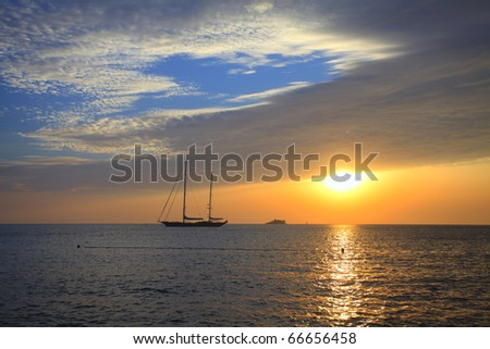 sunset by the yacht - stock photo