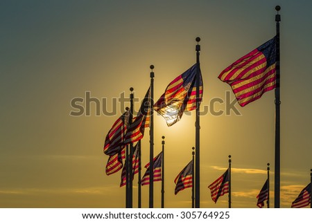 Sunset captured behind the circle of flags at the Washington Monument
