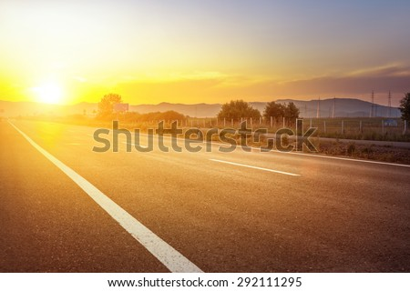 Sunset city road - stock photo