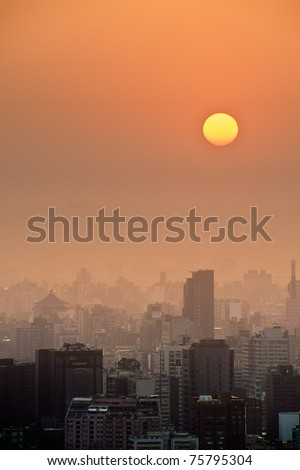 Sunset city scenery with sun and buildings in Taipei, Taiwan, Asia. - stock photo