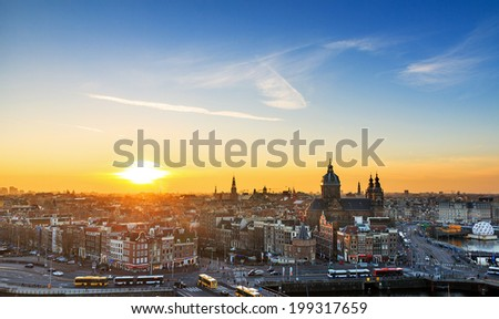 Sunset cityscape in winter of the skyline of Amsterdam, the Netherlands.  - stock photo