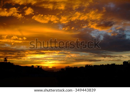sunset cloud with city silhouette