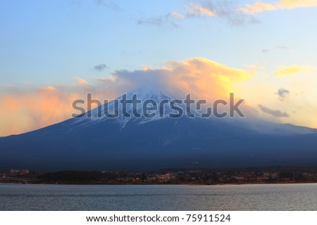 Sunset clouds cover  the top of mount Fuji, Japan - stock photo