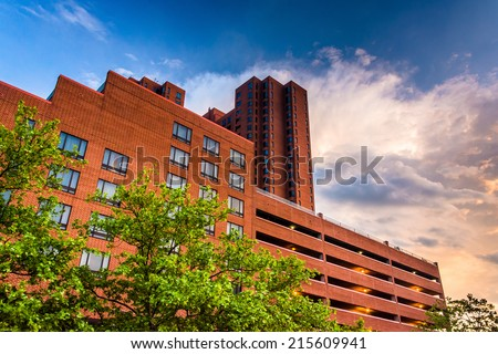 Sunset clouds over buildings at the Inner Harbor in Baltimore, Maryland. - stock photo