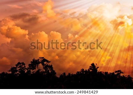 Sunset clouds over dark horizon - stock photo