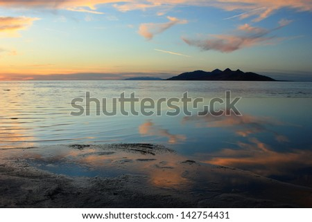Sunset clouds with Antelope Island in the Great Salt Lake, Utah, USA. - stock photo
