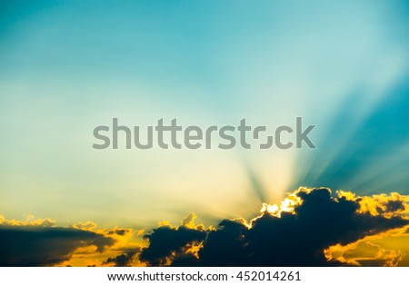 Sunset clouds with sun rays