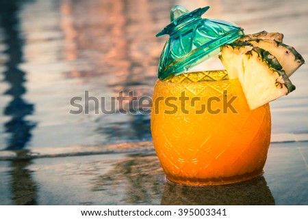 Sunset cocktails outdoors - stock photo