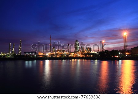Sunset colorful sky and petrochemical industry. - stock photo