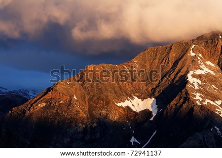 Sunset colors in Gran Paradiso National Park, Italy - stock photo
