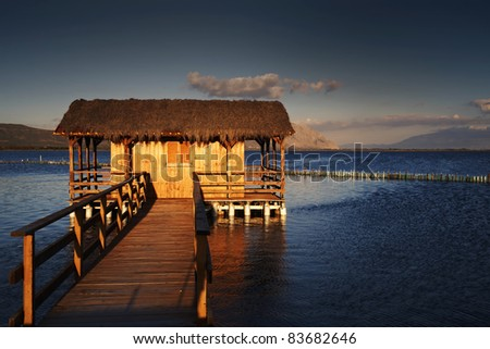 sunset colors of the wood house - stock photo
