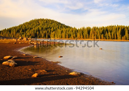 sunset colors over the mountain hill - stock photo
