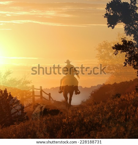 Sunset cowboy riding a horse over the mountains into the sunset. - stock photo