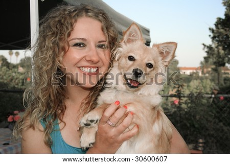 Sunset, Dog and girl together in the garden - stock photo