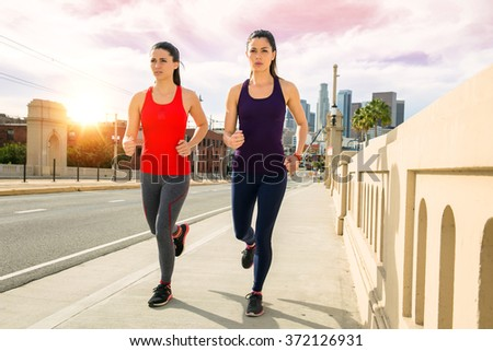Sunset downtown skyline women exercise fitness healthy lifestyle active calorie burning - stock photo