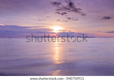 Sunset dramatic colorful tropical sea sky and cloud background,Long exposure image