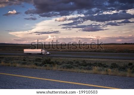 Sunset Driving - blurred Semi-truck - stock photo